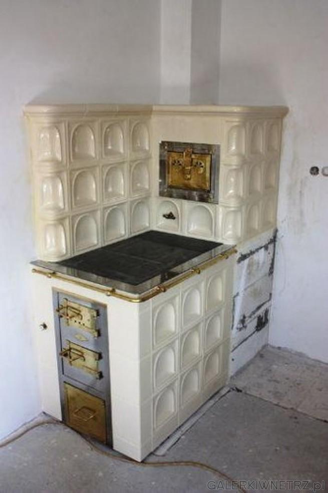 Kaflowa kuchnia, która jest nawiązaniem do kaflowego kominka z otwartym paleniskiem. ...