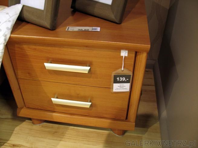 W ofercie znajdziemy stolik nocny wykonany z drewna, z dwoma szufladami i srebrnymi ...