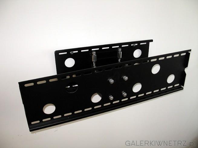 Uchwyt LCD mocowany jest do ściany na kołki. Kołki i śruby znajdują się w ...