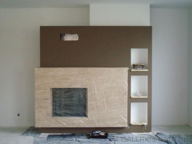 Projekt kominka minimalistycznego, składającego sięz ciepłych barw. Kominek został ...