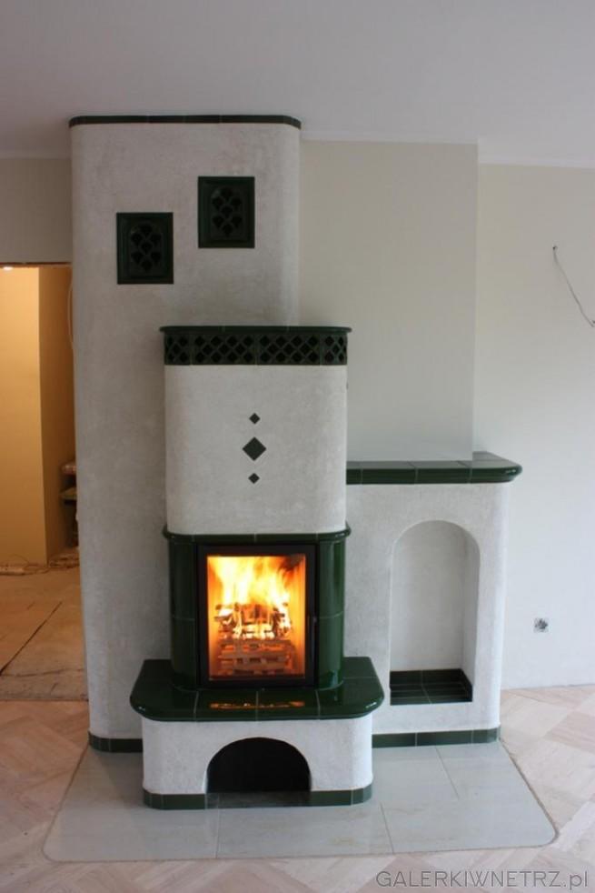 Oryginalny i wyjątkowy kominek, w jasnych kolorach z domieszkązieleni. Motywem ...