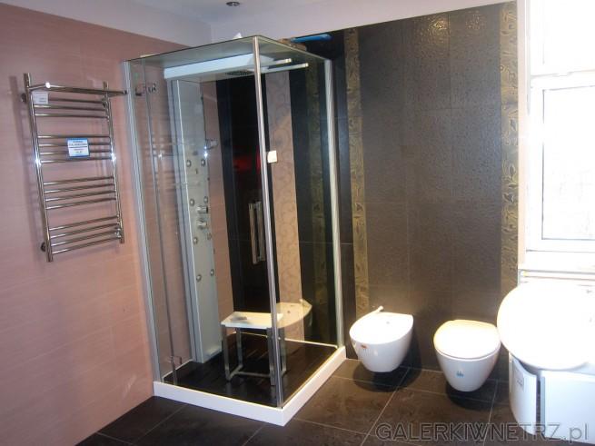 Bardzo ekskluzywna, elegancka aranżacja łazienki utrzymana w ciepłych brązach, ...